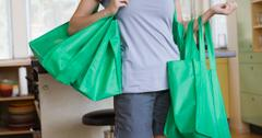 How do reusable grocery bags help the environment?